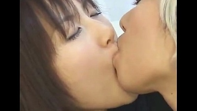 Japanese Fruity Schoolgirl Giving a kiss Another Girl in Drag