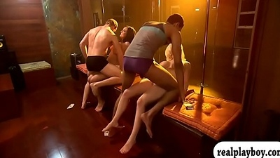 Two sexy ladies having fun in pole daning with the guys